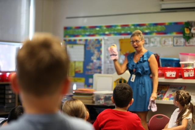 teacher holding puppet