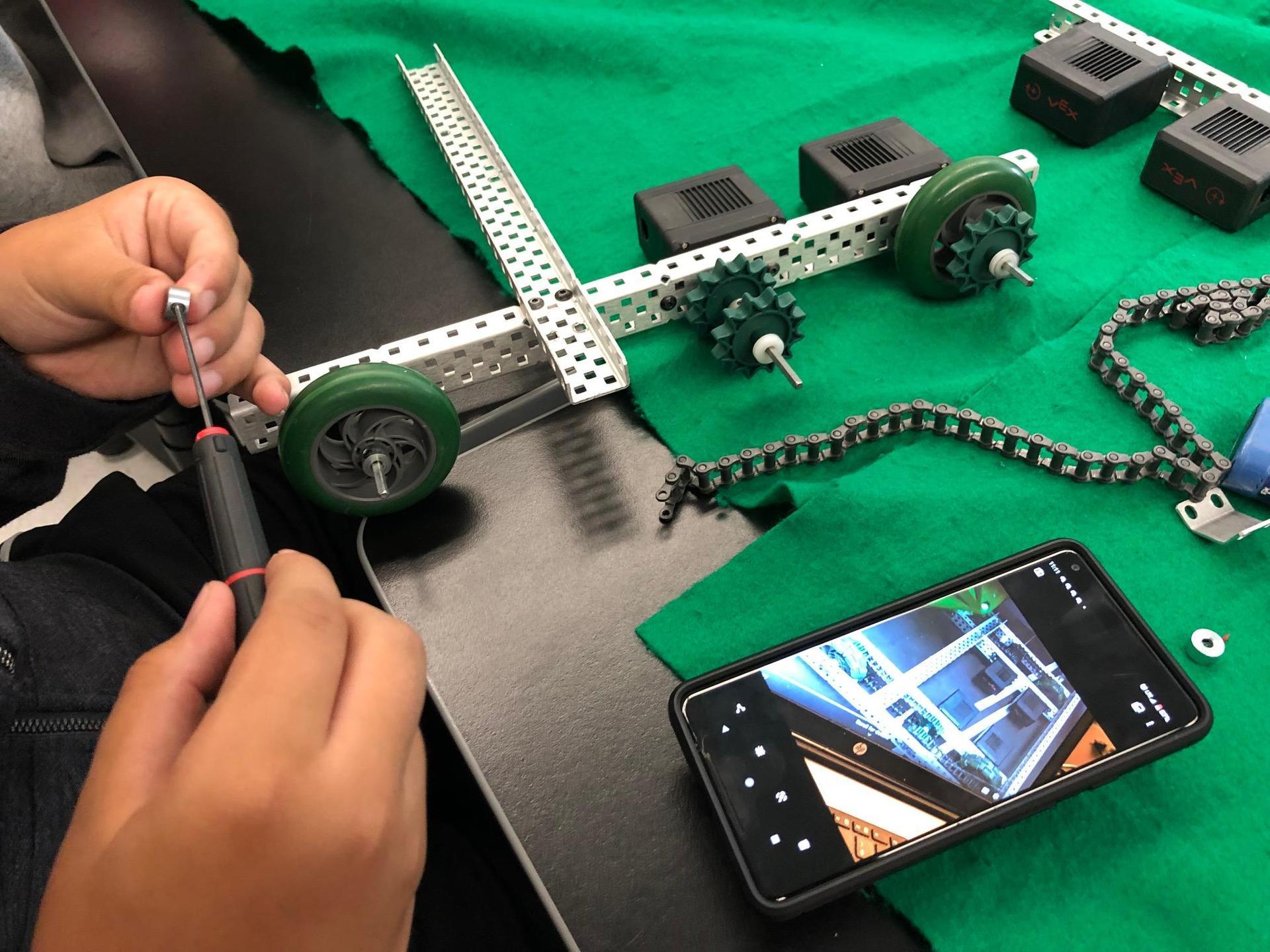 student working on vex robot 1