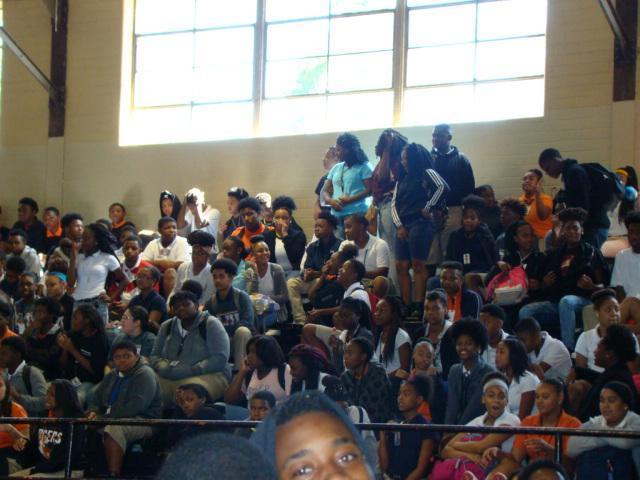crowd looks on