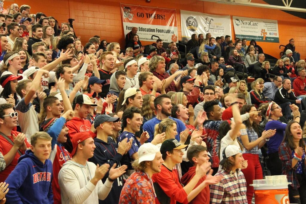 Students cheering in bleachers