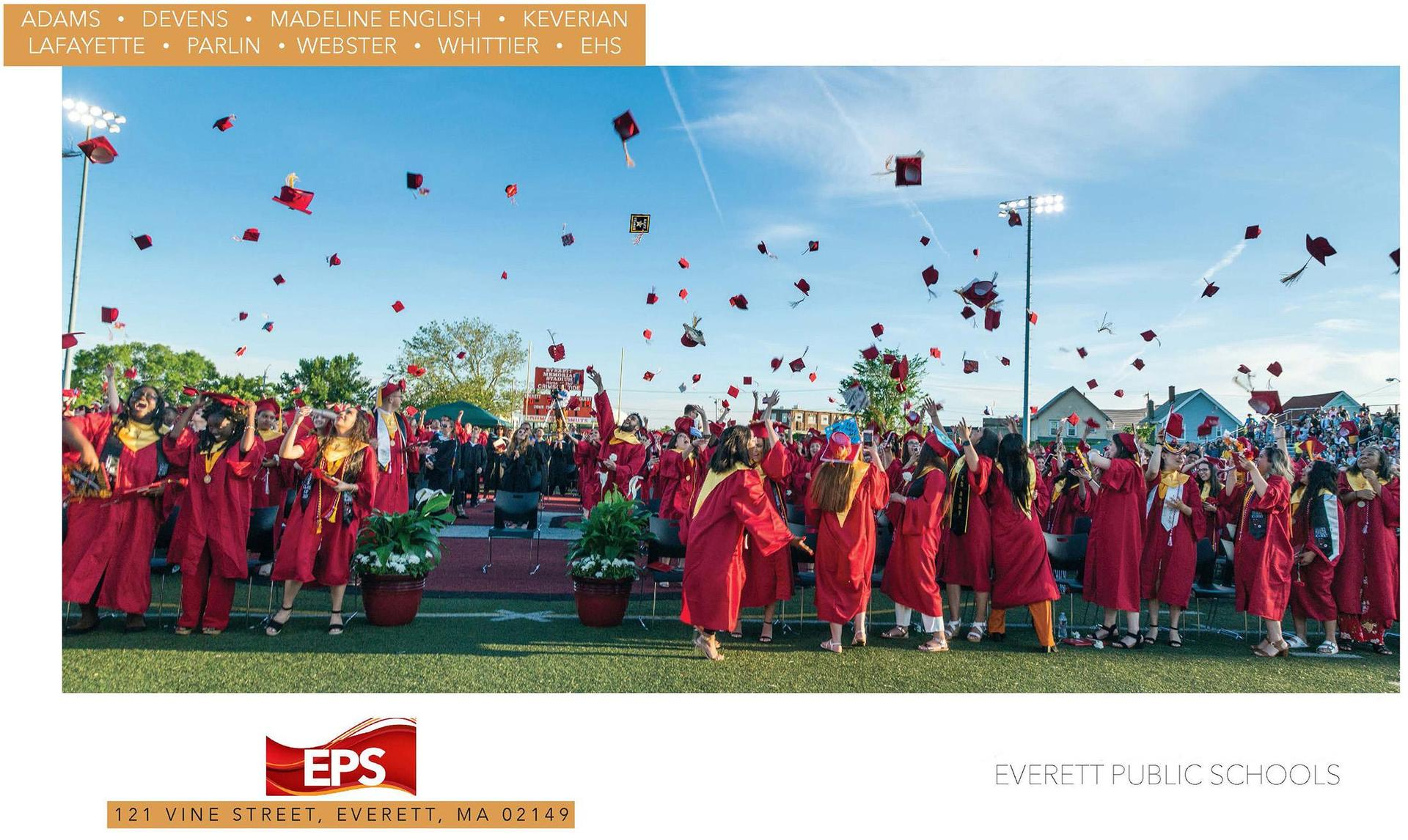 EHS graduates toss their caps into the air inside Veterans Memorial Stadium