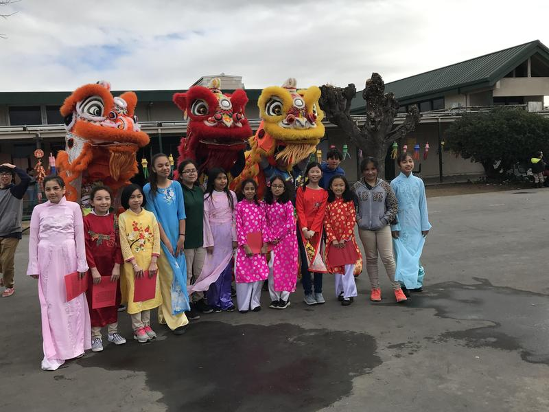 Lairon student representatives pose with the lions after the lion dance performance.