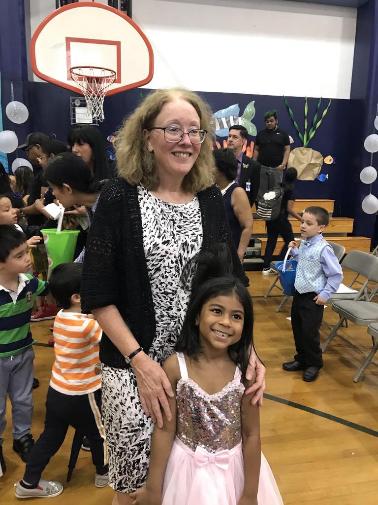 Principal with little girl