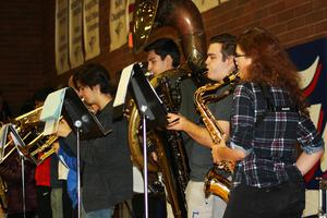 teenagers playing instruments