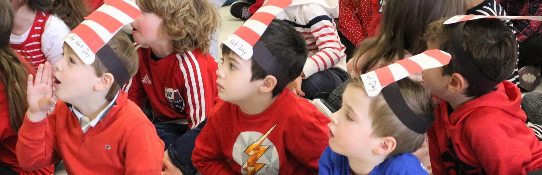 Photo of Lincoln School kindergartners wearing handmade Cat in the Hat hats as part of the celebration of Read Across America Day.