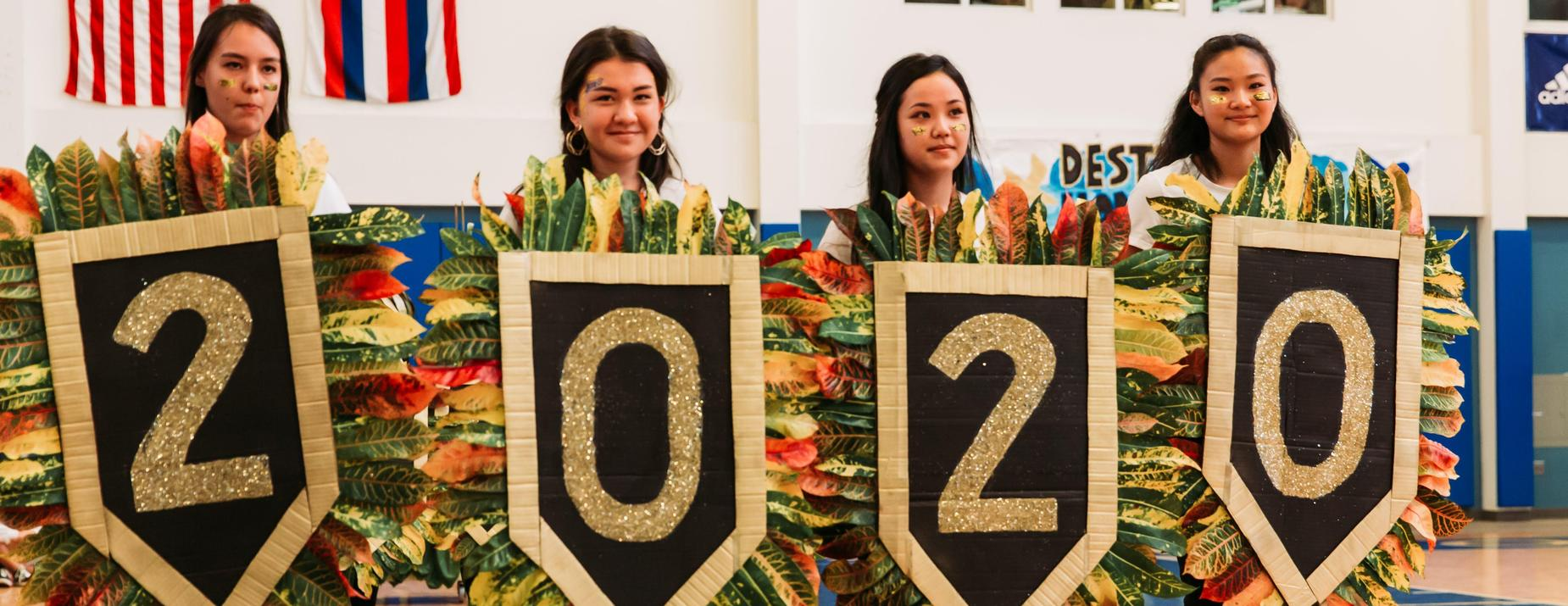 Students spell out 2020 using homemade shields.