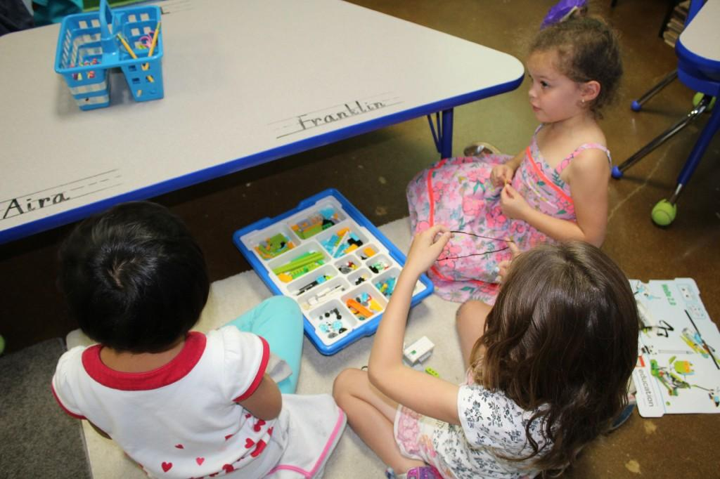 First graders build lego robots, which they will program later in the year.
