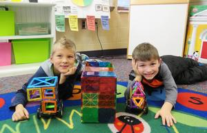 Students in Molly Bumstead's classroom display their creations using the building toys.