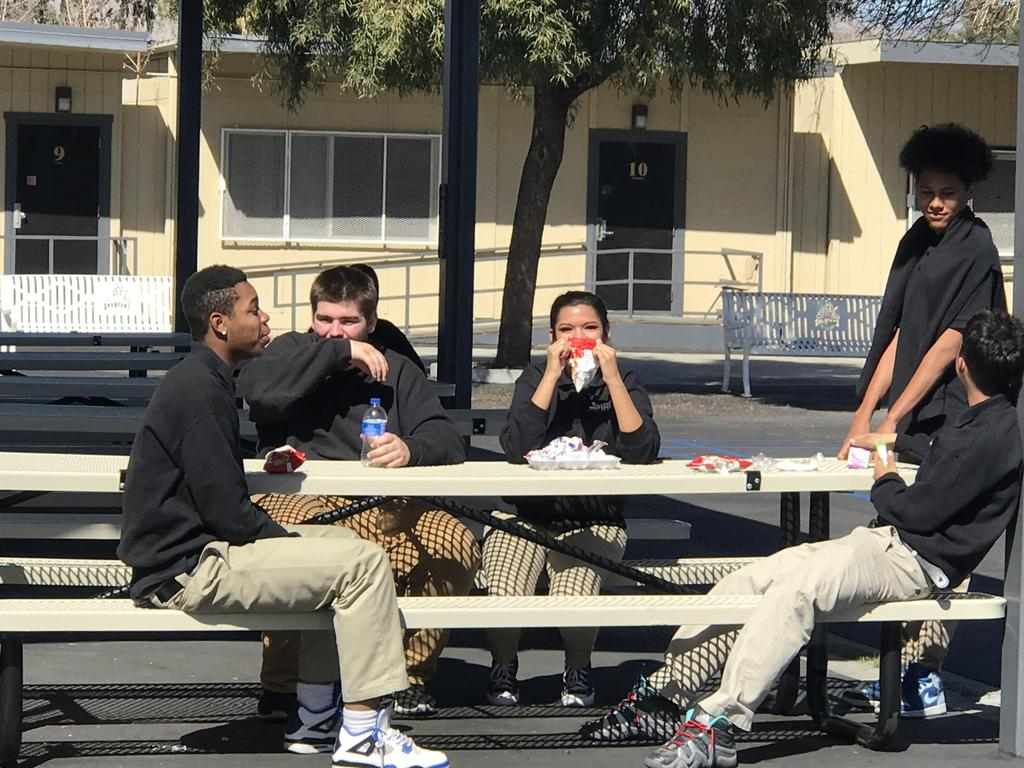 Students kicking it at lunch.
