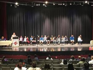 photo of the stage with students participating in the Spanish spelling bee