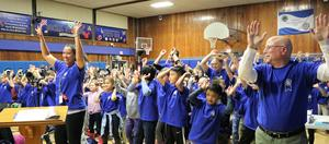 Photo of Washington School students and staff dancing during Blue Ribbon celebration at Board of Education meeting.