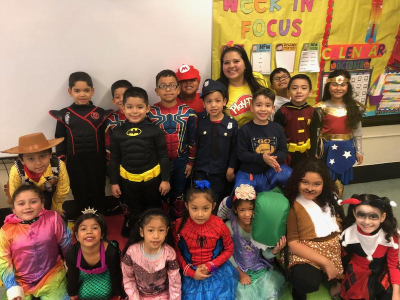 teacher with her class showing off their costumes