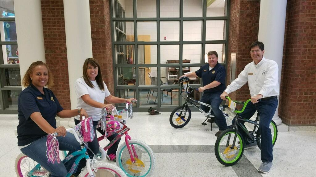 Administrators with prize bicycles