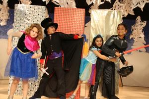 4 students in various costumes