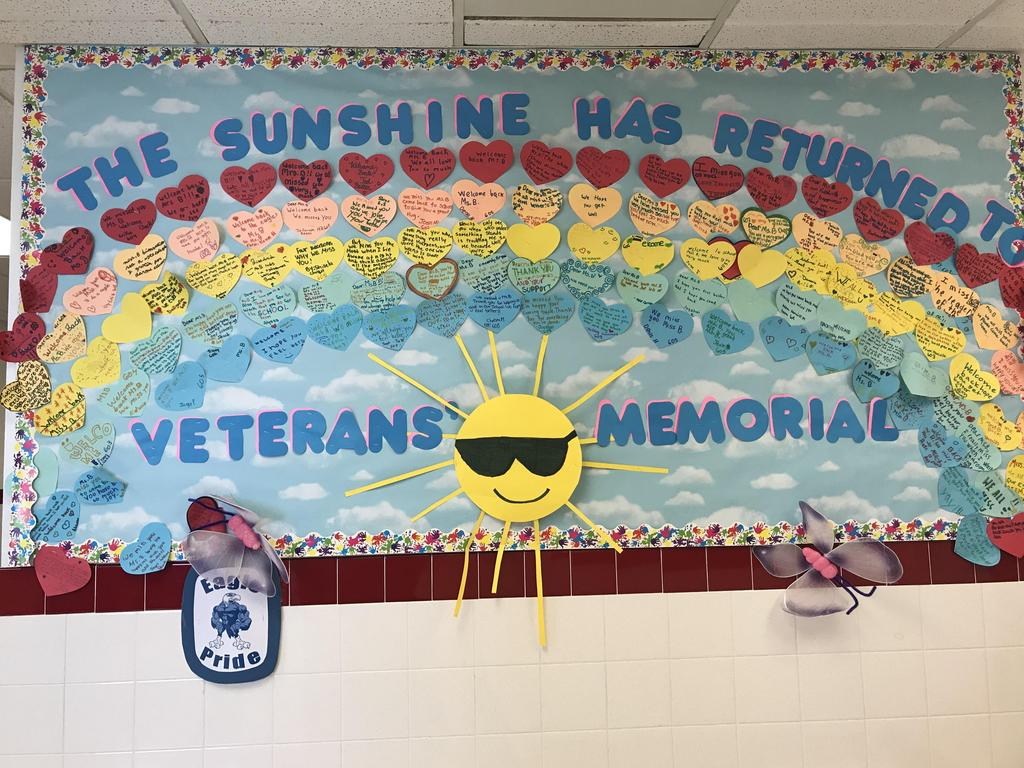 bulletin board display: the sunshine has returned to Veterans Memorial a sun with heart colored rainbows