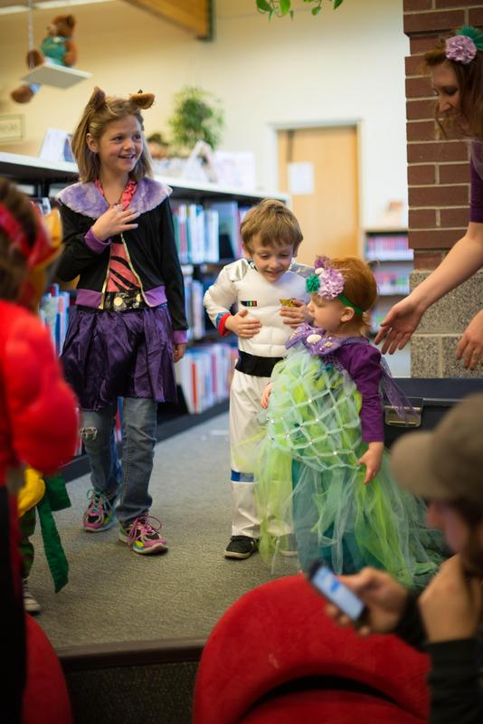 Photo depicts children at a school party with costumes