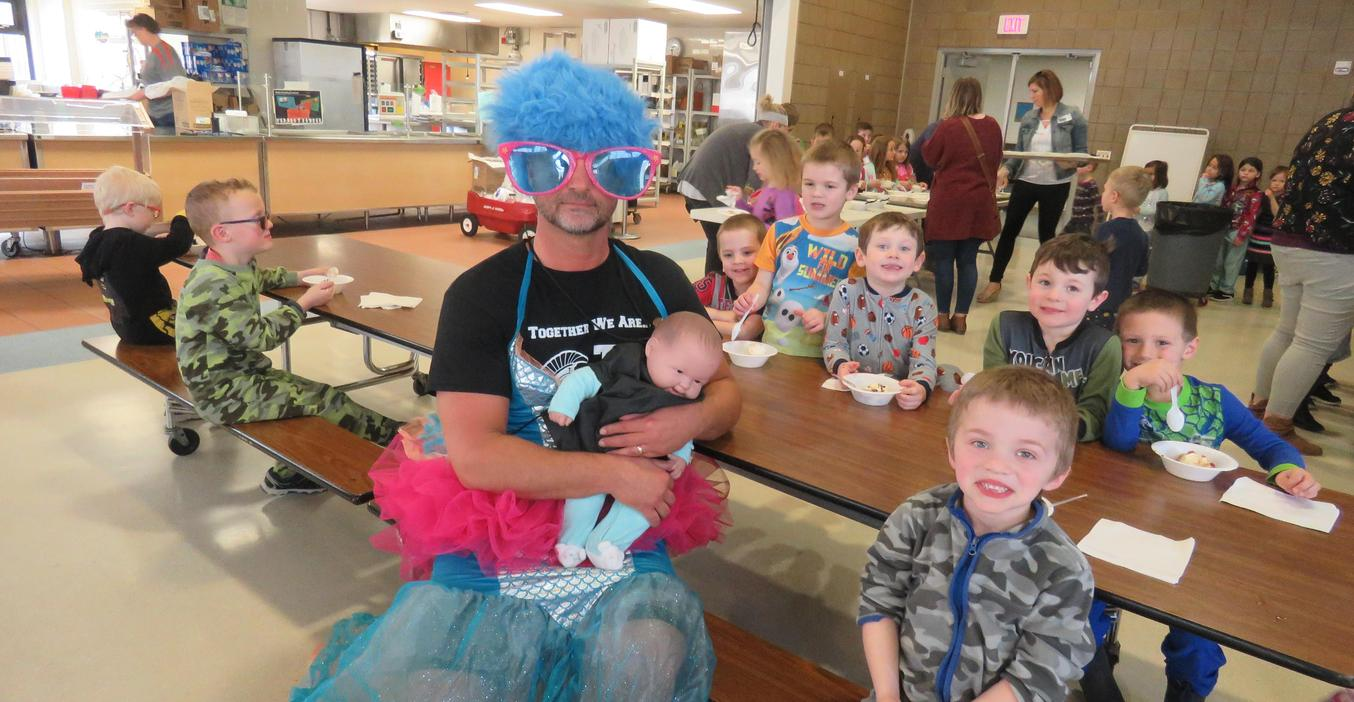 Principal JonWashburn dressed up after students met their reading challenges.