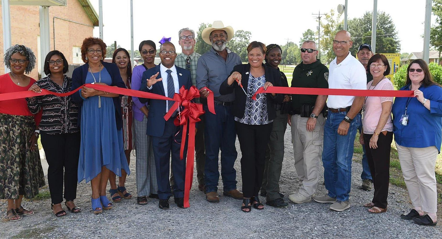 RIBBON CUTTING - NEW ACCESS ROAD FOR LAWTELL ELEMENTARY *Photo Credit - Daily World