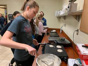 NHS student making pancakes