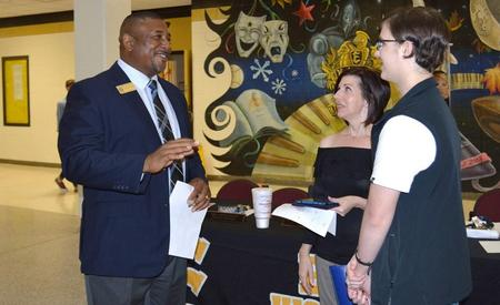 Dr. Tyson talking to parent and student