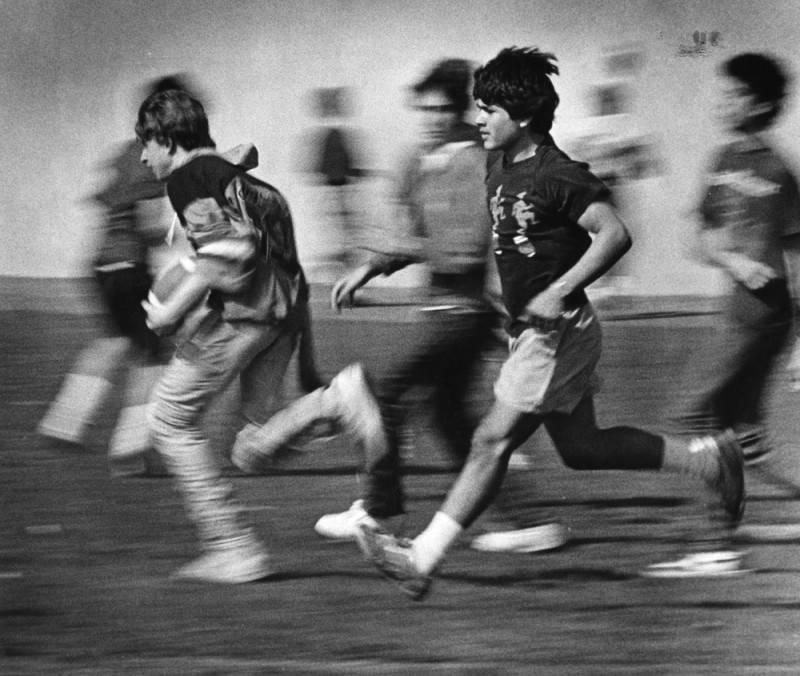 """According to the public library records, students are running during """"noontime physical activity program."""" Principal at the time was Jerry Kantor. Photo was taken January 29, 1986."""