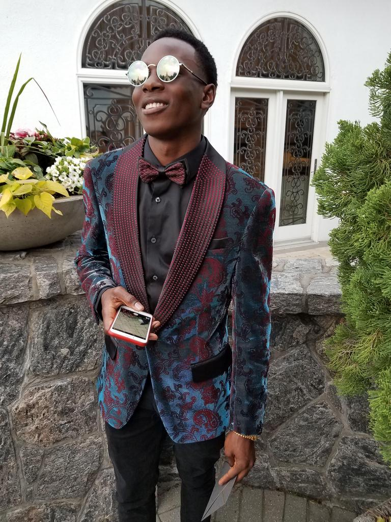 Student smiling wearing a suit