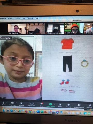girl showing her clothing drawing on zoom