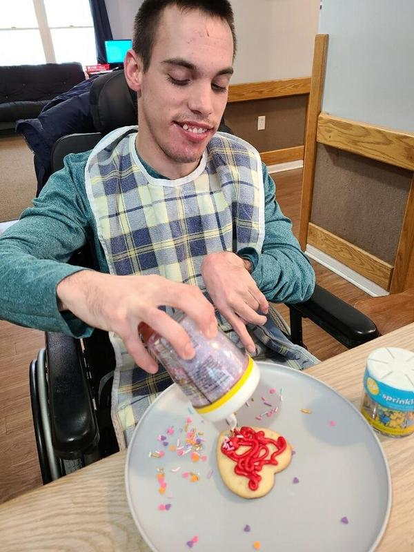 Man decorating a cookie