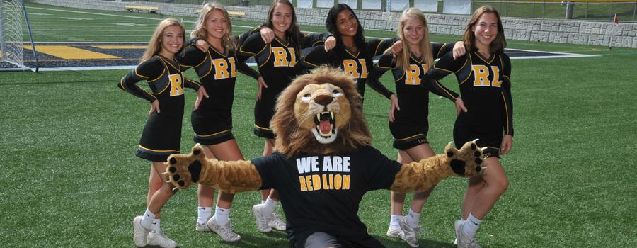 Senior football cheerleaders with the lion mascot