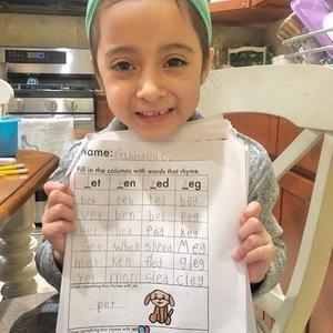 girl holding up her letter packet