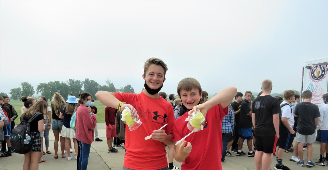TKMS students turn their frozen treats upside down to show it won't fall out of the cup!
