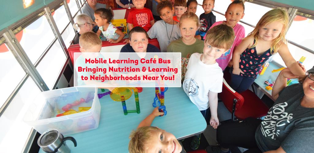 A pic of children inside QISD Mobile Learning Cafe Bus Delivering Nutrition and Learning to a Neighborhood Near You