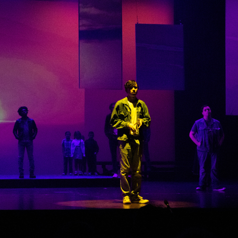 students acting on stage