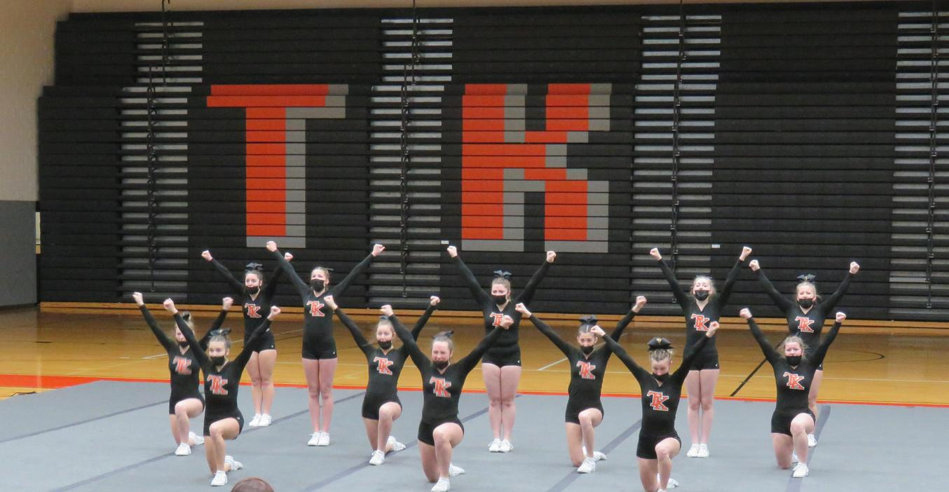 TKHS Cheer team performs a routine.
