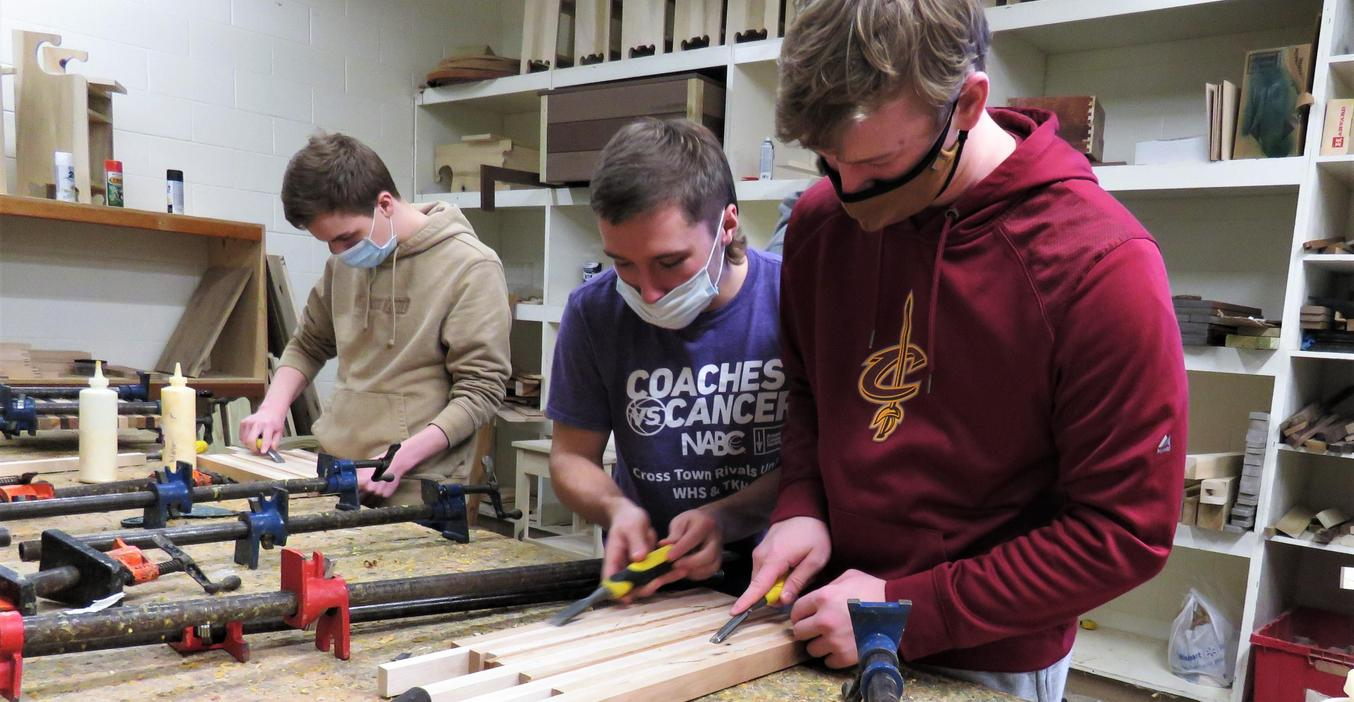 Woods students work on making cutting boards.