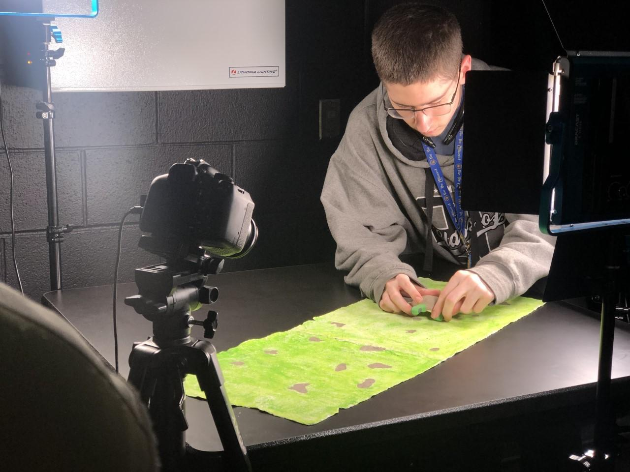 a/v student working on project