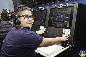 "Sebastian Cabrera, a 7th grader at Edison Intermediate School, is a ""communications specialist"" in the ""command center,"" one of 63 students and 9 staff who took part in a simulated space mission as part of a 5-day STEM field trip that included a visit to the U.S. Space and Rocket Center in Huntsville, Alabama."