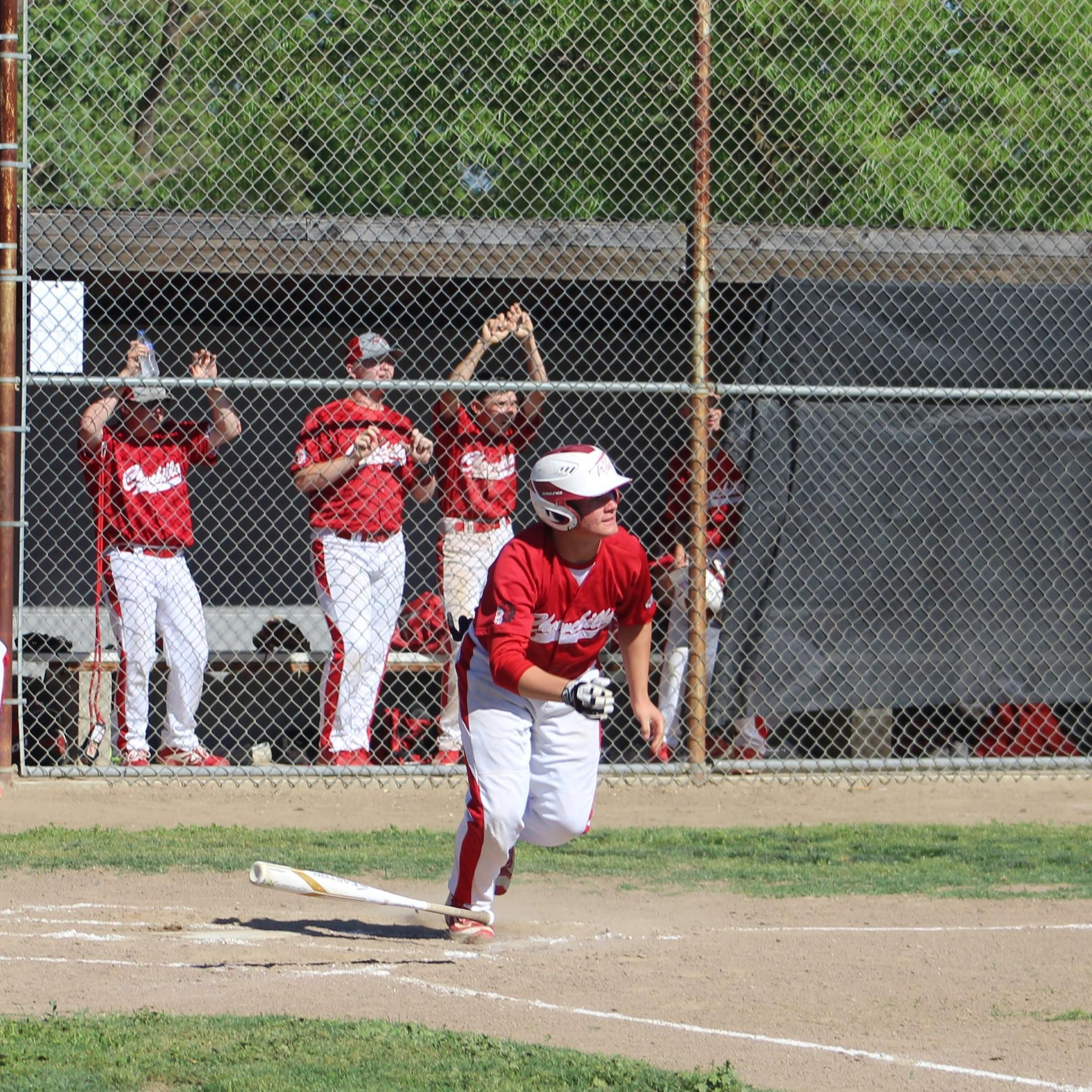 JV baseball players in action against Washington Union