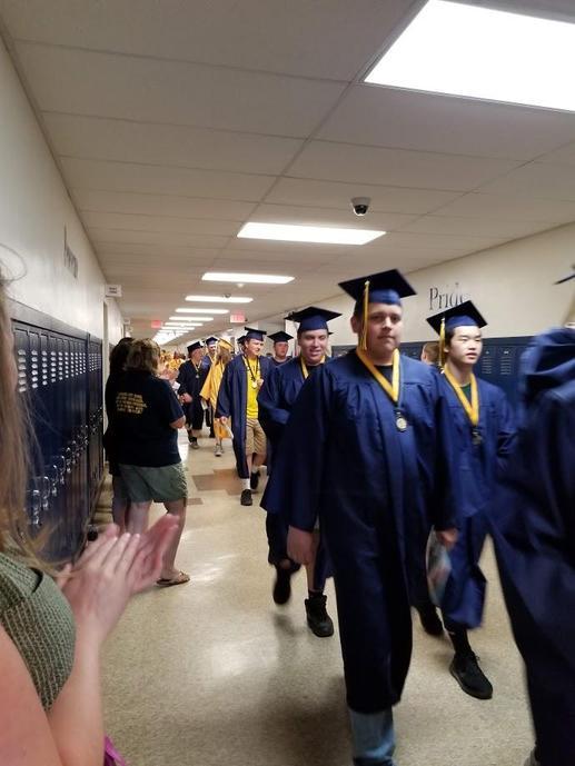 Graduates walking through Wagar Middle School