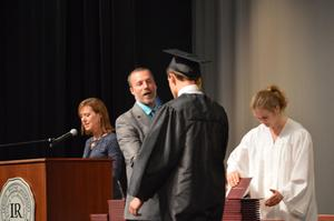 Mr. Whitener gives Holden Abernathy his diploma
