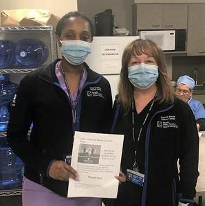 :   Members of the Overlook Radiology Department enjoy a donation of food and a note of thanks from the Roosevelt Intermediate School Student Government.