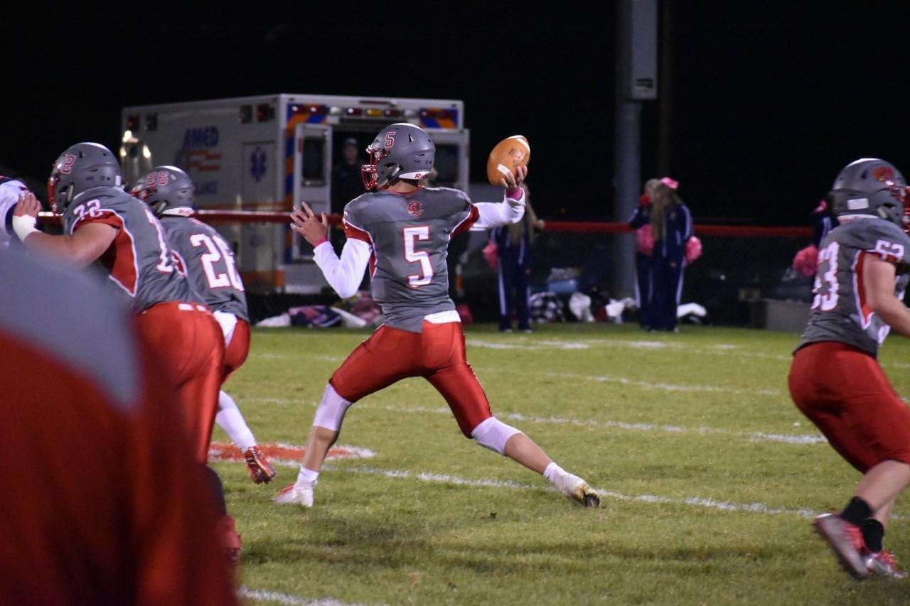 Senior quarterback Braden Kitt attempts a pass on Senior Night.