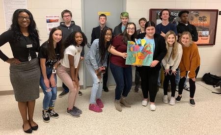 picture of students holding a birthday card