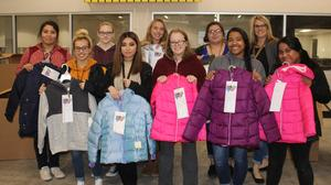 Students with donated coats