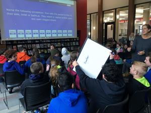 Students play a game of jeopardy.