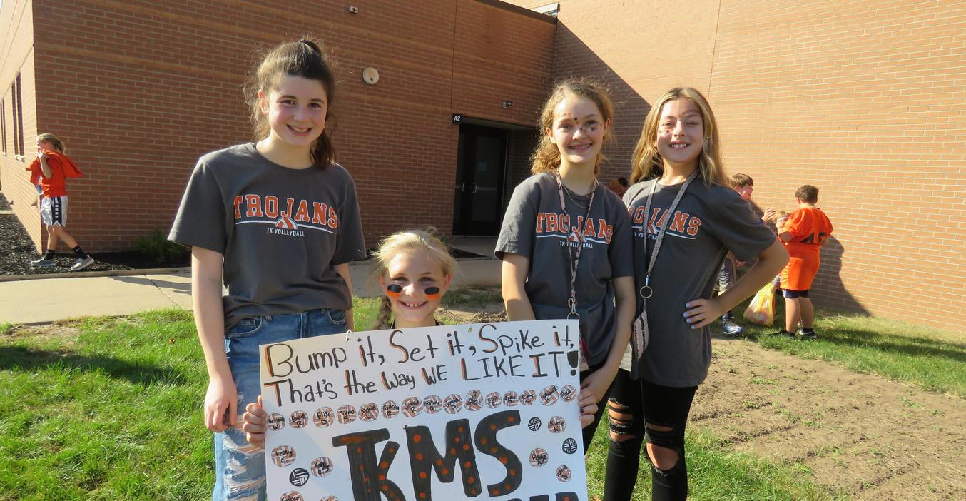 TKMS volleyball team members pose for a photo at the homecoming parade.