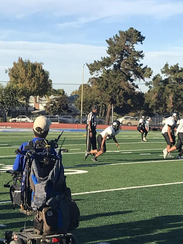 prospect high school coach rob mendez on football field