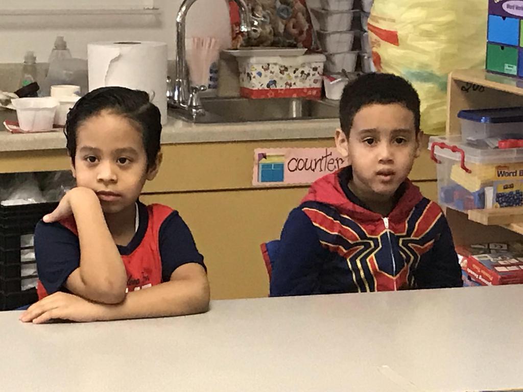 two boys wearing pj's waitiing