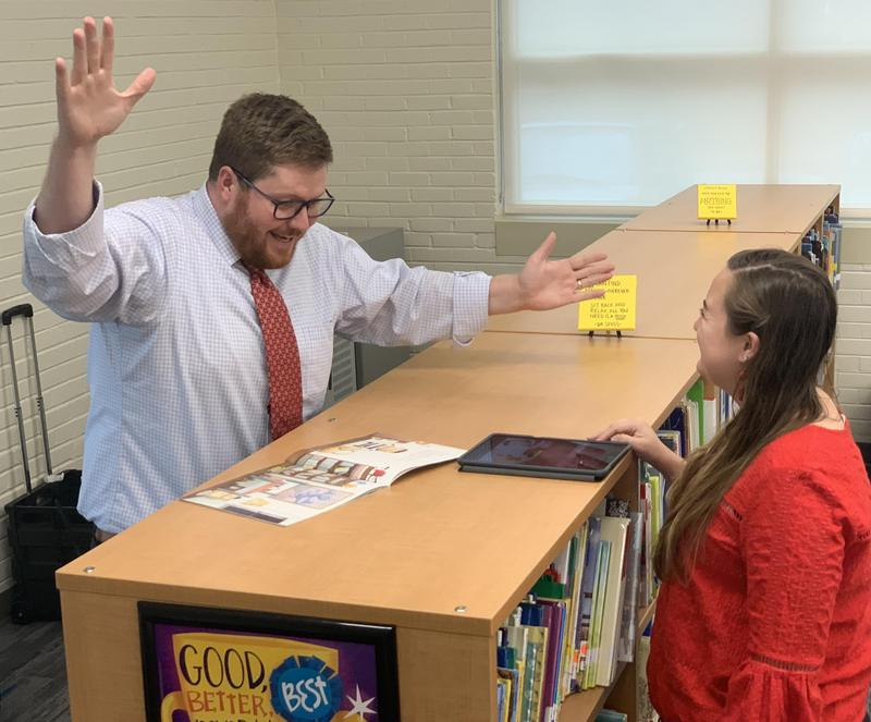 Saluda River Academy for the Arts Principal Jim LeBlanc gets animated as he records a book reading with the help of media specialist Jess Land.