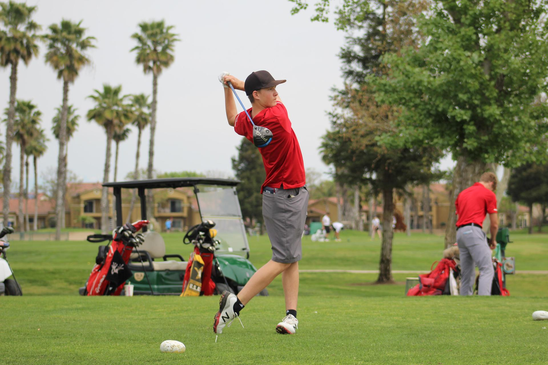 Golfers in action against Riverdale